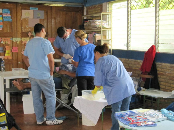 Providing dental care in Nicaragua: Dr. Holt performing a routine dental exam on one of his mission trips to Nicaragua with the Grapevine Church of Christ.